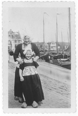 Photograph of mother and child, wearing Dutch-style clothing